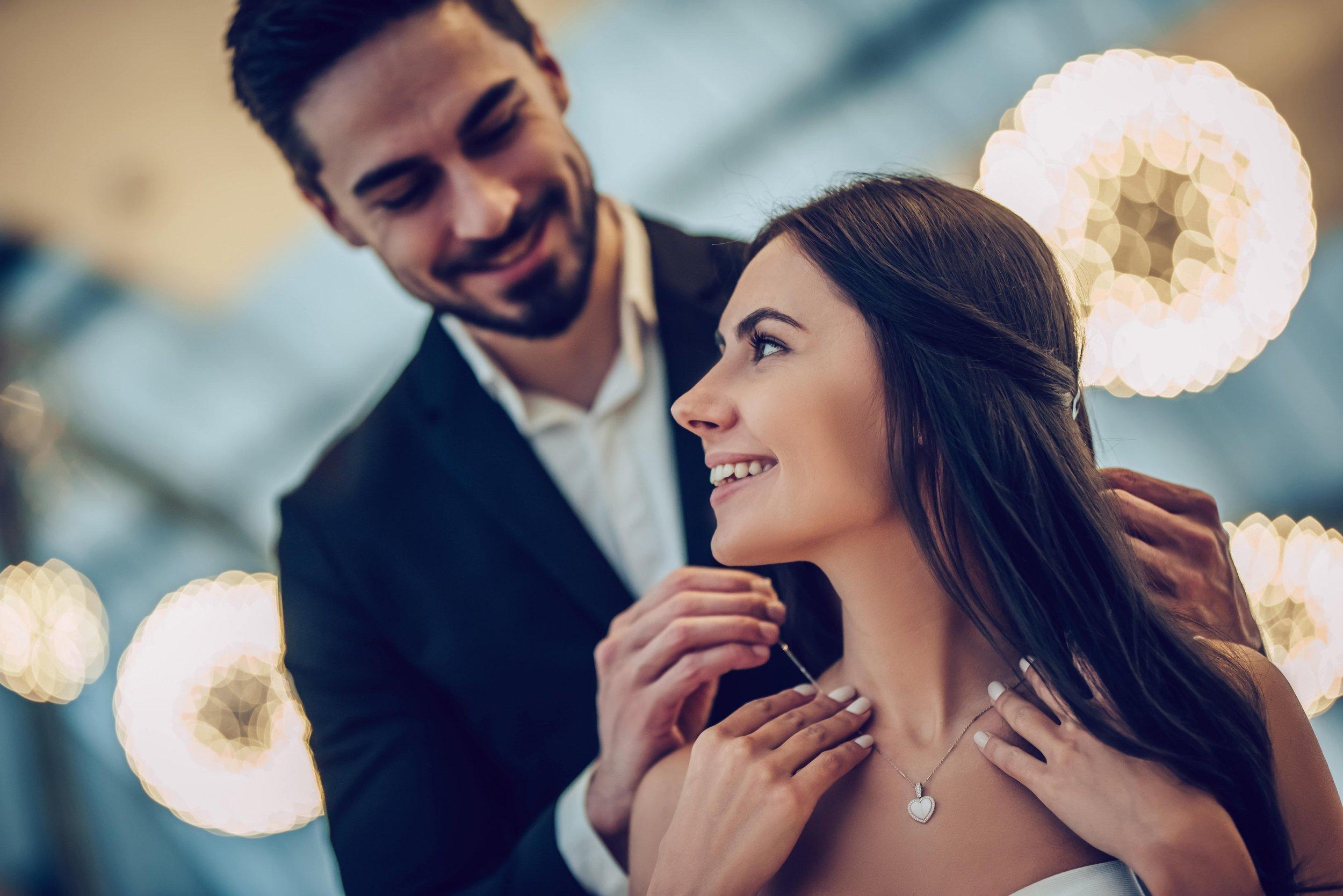 happy couple with new jewelry