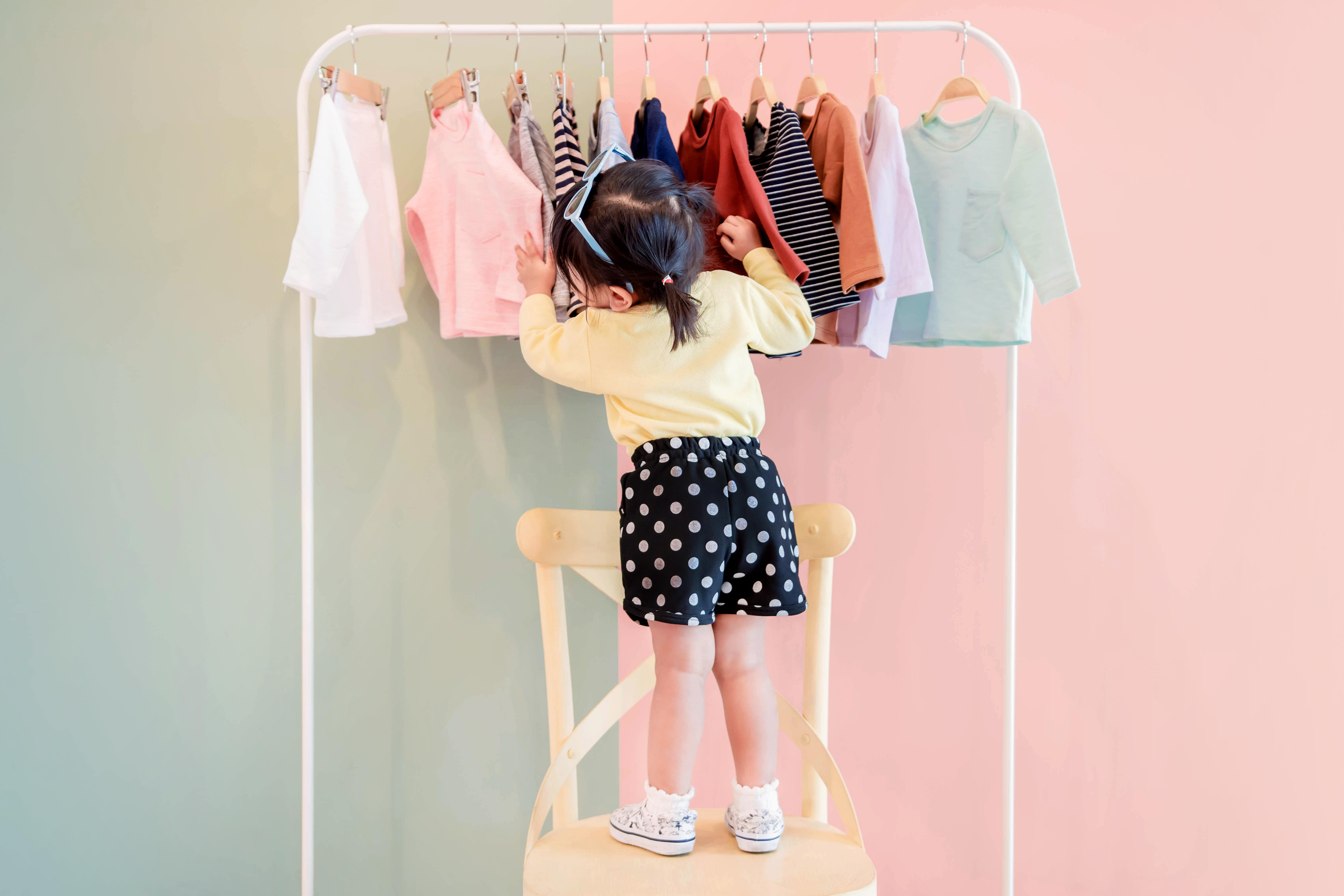 Little girl looking for the perfect dress